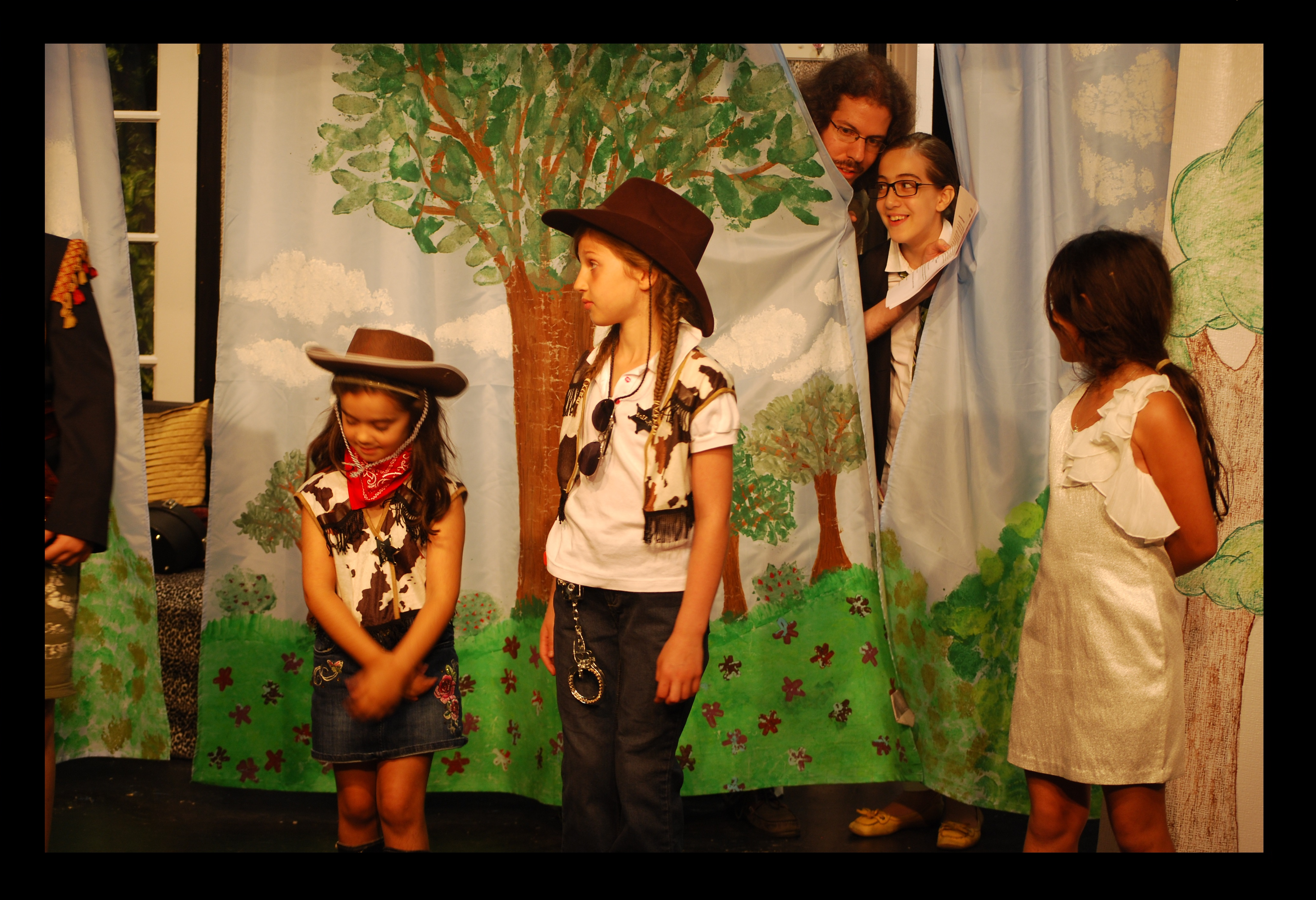 Alex Malaos directing a children's theater play